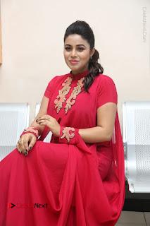 Actress Poorna Latest Stills in Red Dress at Rakshasi First Look Launch  0239.JPG