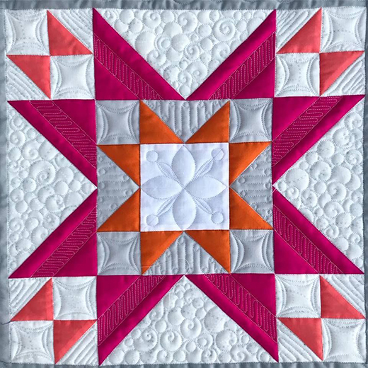 The Atlas Star Block designed by Gina Perkes of The Copper Needle for the National Quilters Circle Quilt Block Challenge