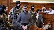 Tagadja bűnösségét a tömeggyilkosságokkal vádolt szír férfi
