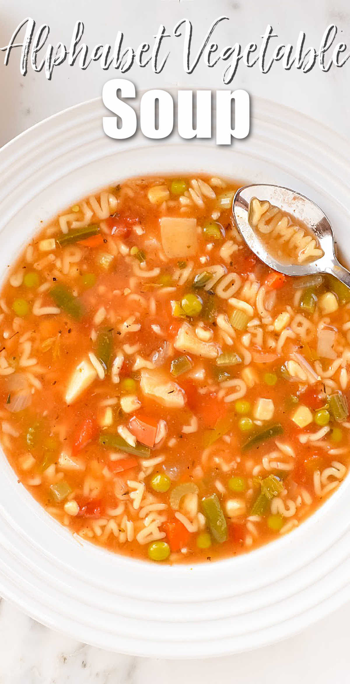Alphabet Vegetable Soup homemade in a white soup bowl with white text at the top Alphabet Vegetable Soup.
