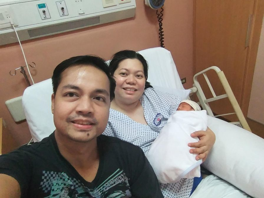Mommy, Daddy, and baby Rafa in a private room in St. Luke's BGC