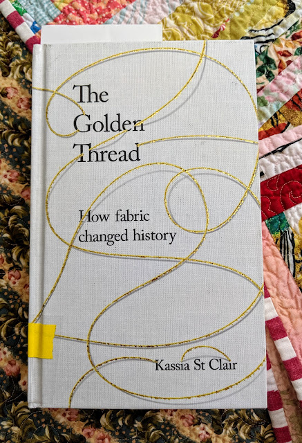 The cover is printed with the title and author and embellished with loops of golden thread.