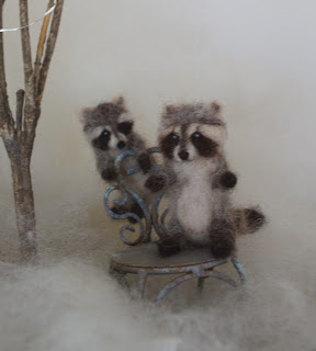 Raccoons in snow
