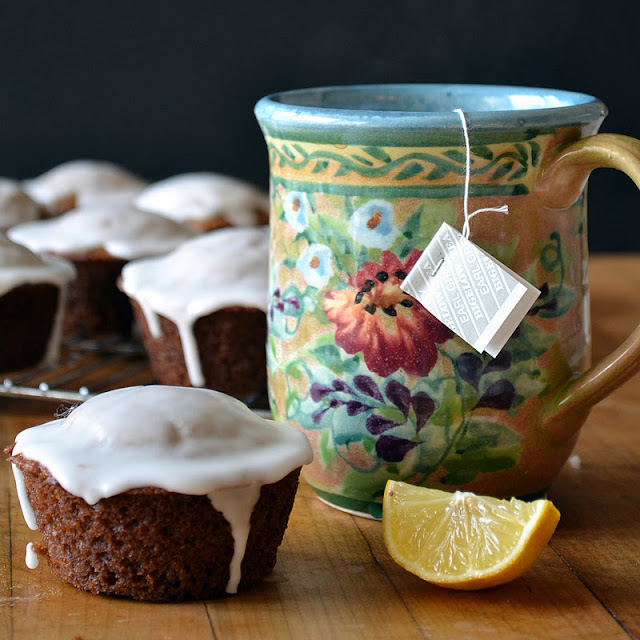 Gingerbread muffins with lemon glaze and a cup of tea