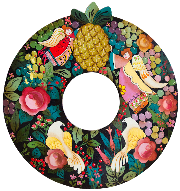 This wooden wreath is painted with old-style traditional birds, fruit and leaves and used at Christmas.