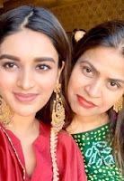 Nidhhi agarwal with here mom images