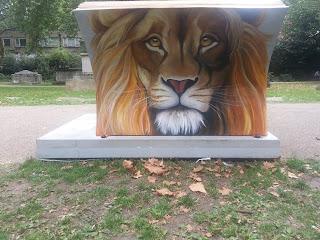 Looks like a lion's head on a gravestone (it isn't really)