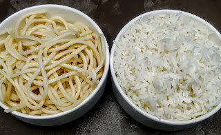 Boiled rice and noodles in bowl for triple schezwan rice recipe