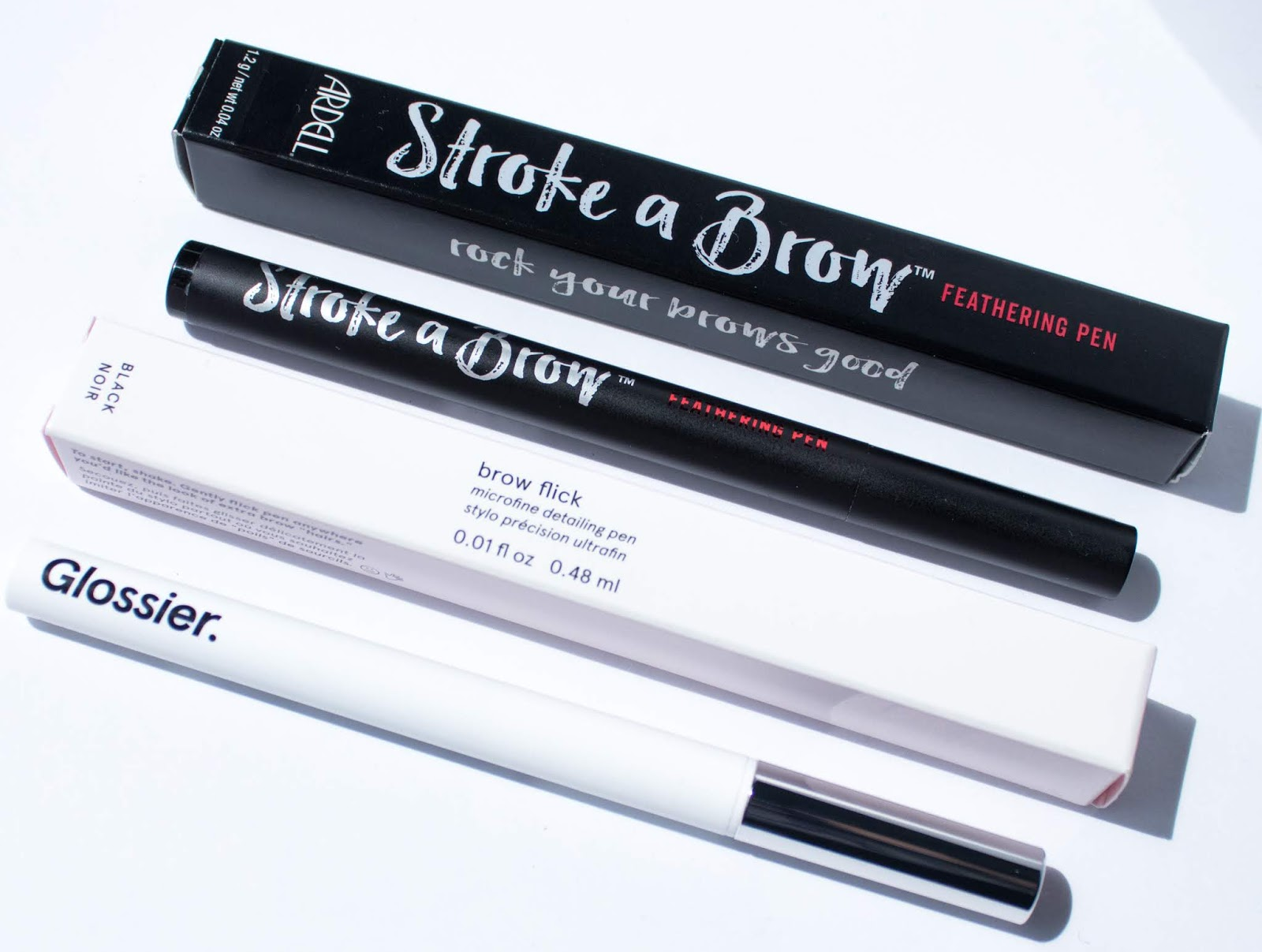 Glossier Brow Flick vs. Ardell Stroke a Brow Comparison