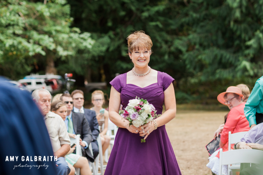 bridesmaid in purple dress walking border=