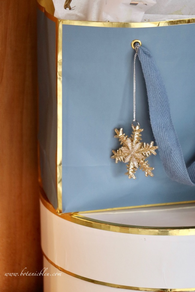 French country blue Christmas presents with glittery star decoration hanging to be seen while displayed
