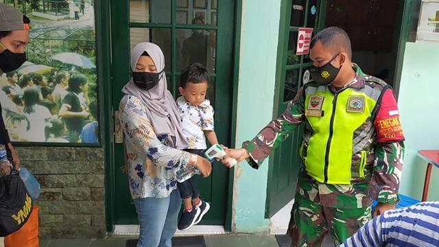 Protokol Kesehatan Diterapkan Personel Jajaran Kodim 0207/Simalungun Ditempat Wisata