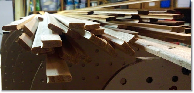 Strips of cedar prepped for building a canoe.