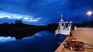 Fishing boat at a quay at night