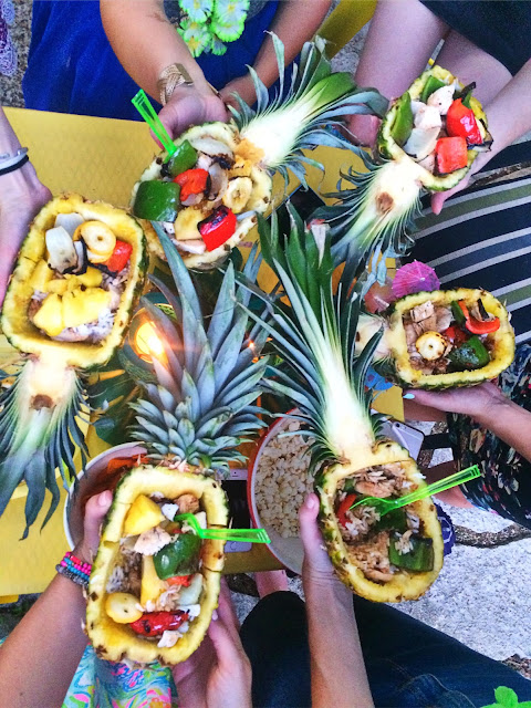 Girls night idea! Hollowed out pineapples with rice, and grilled chicken & veggies!