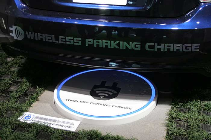electric car wireless charging at parking station