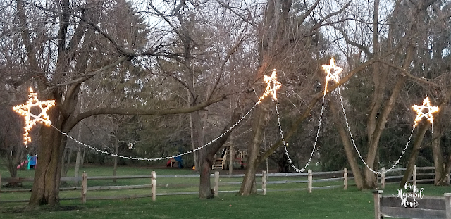 chain 4 hanging wooden stars Christmas lights