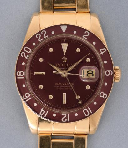 vintage rolex gmt master yellow gold brown bakelite