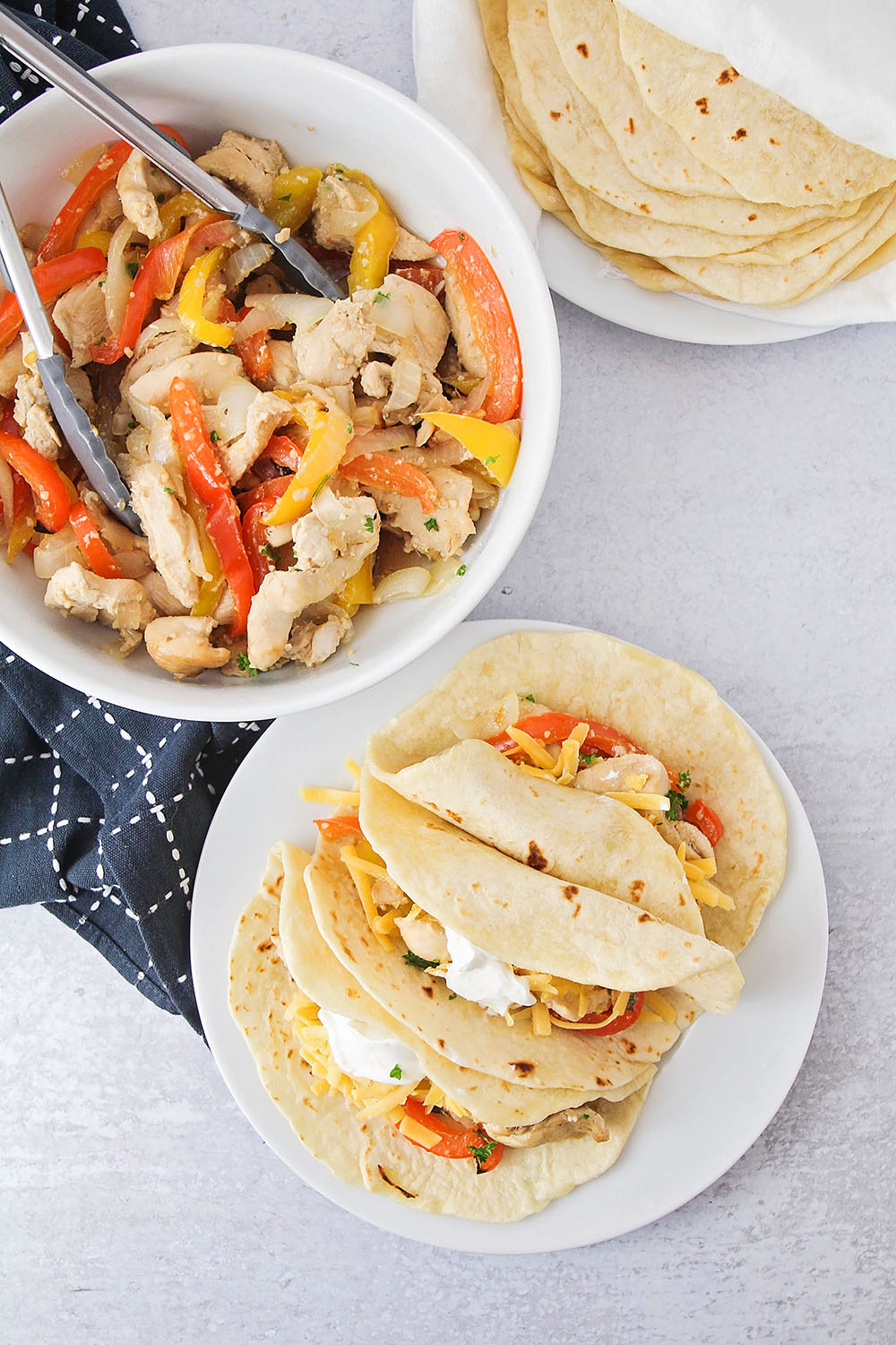 These sheet pan chicken fajitas are simple to make, and bursting with delicious flavors. It's an easy weeknight meal that's sure to please!