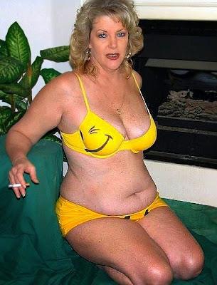 Older blond slut wearing a pink bikini