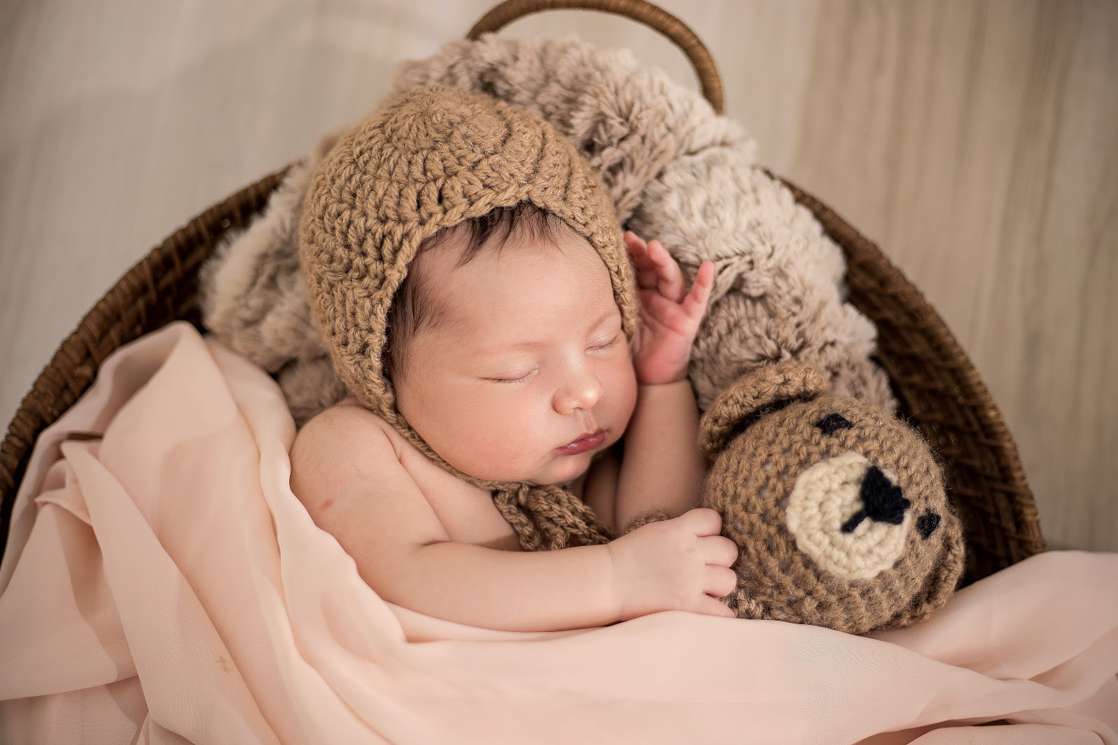 baby-wearing-brown-knit-cap-while-sleeping-pictures