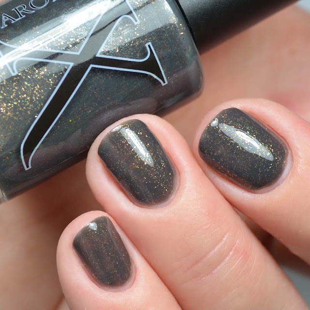 grey nail polish with bronze flecks swatch