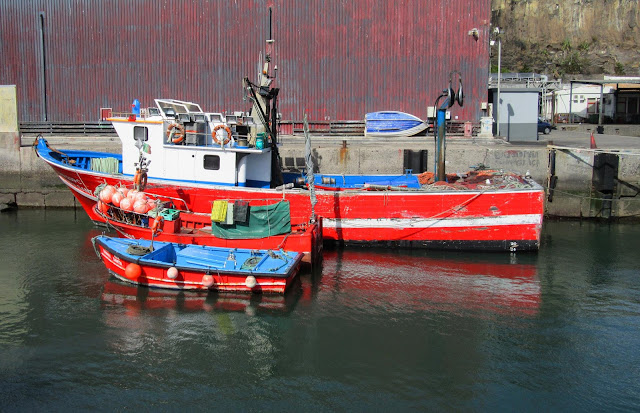 three fishing boats, the same color