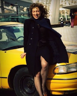 Florian Haertel's ex-wife Alex Kingston posing for picture with car