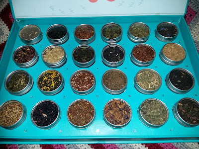 24 Steeps 'till Christmas tea sampler includes: Earl Grey de la Crème,  Harvest Spice, Winter Sangria, Sleepy Chai, Feel Good Fennel,  Berry Mania, Very Cranberry,  Mint Chocolate Chip, Cocoa Mint,  Chocolate Date Night, Crème Carmello,  Wintermint,  Zinger Ginger,  Egg Noggin'