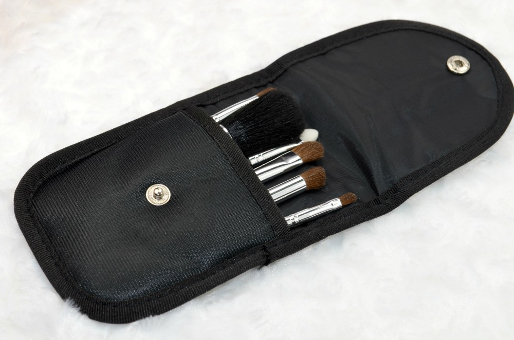 Image of the brush pouch open with the brushes inside