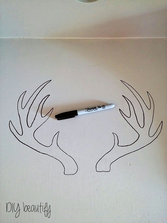 Use a Sharpie to outline a design on furniture, then fill in with paint! www.diybeautify.com