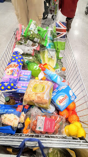 A filled Aldi Shopping Trolley