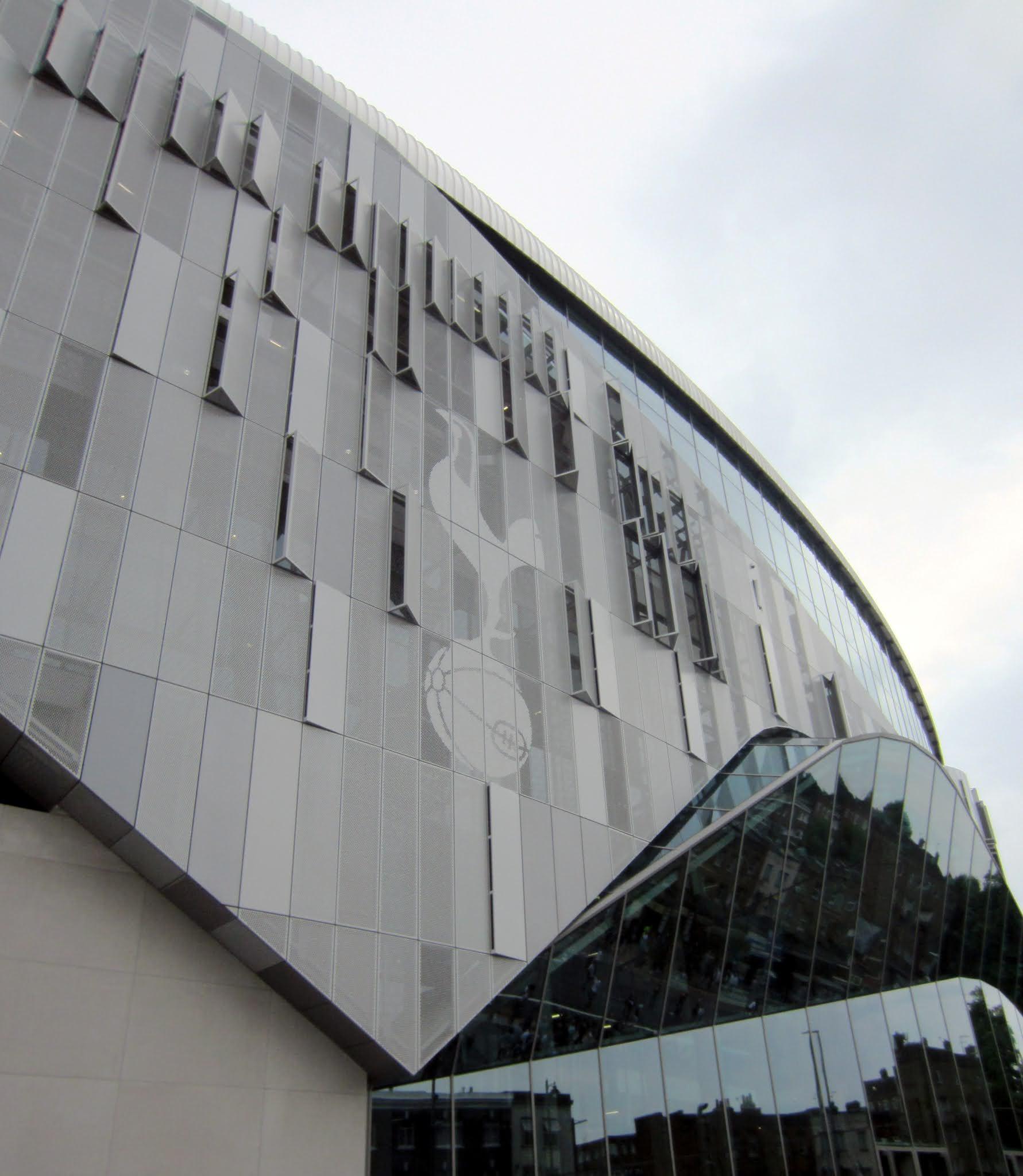 Tottenham Hotspur logo on the exterior façade of Tottenham Hotspur Stadium