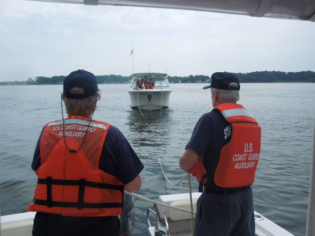 C. Stiles and R. Coleman paying out towline