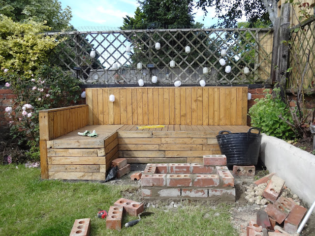 brick fire pit near pallet seating