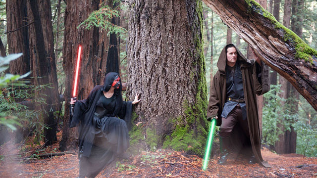 jedi versus sith cosplay in a forest