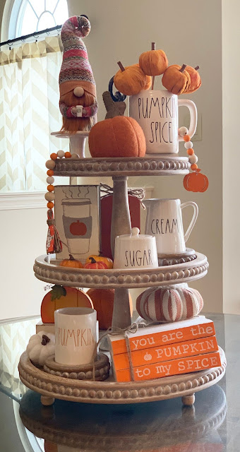 tall wood tiered tray styled for fall
