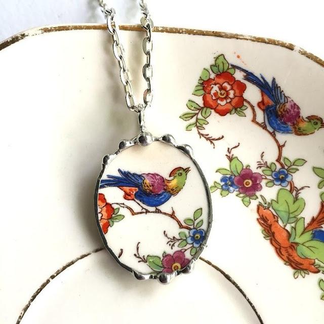 Broken china jewelry bird pendant by Laura Love.