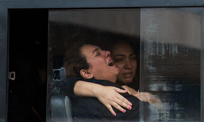 A mother crying during bombing victims' funeral