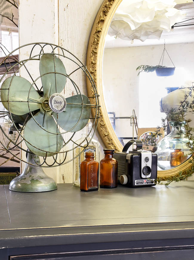 Vintage fan, amber bottles and vintage camera