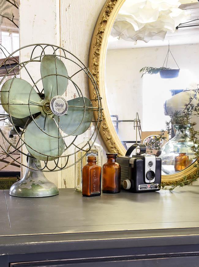 Vintage fan, amber bottles and vintage camera