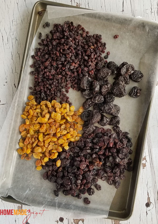 A tray of currants, raisins, sultanas, prunes showing the fruits needed to grind