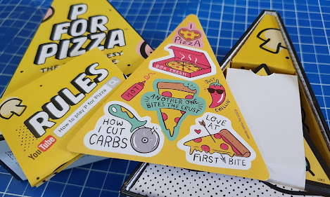 Contents of P for Pizza game box displayed on table