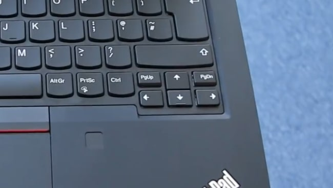 4 Small and closely placed arrow keys on the keyboard.