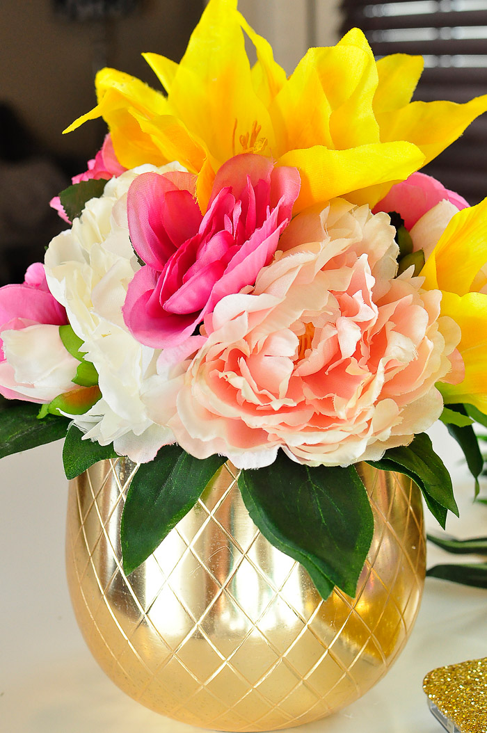 Ideas for how to use dollar store or Dollar Tree florals to create chic floral arrangements and home decor.