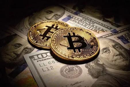 أخبار العالم: سعر عملة بيتكوين bitcoin ينزل إلى 33 ألف دولار
