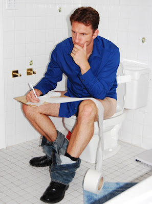 sitting in the toilet