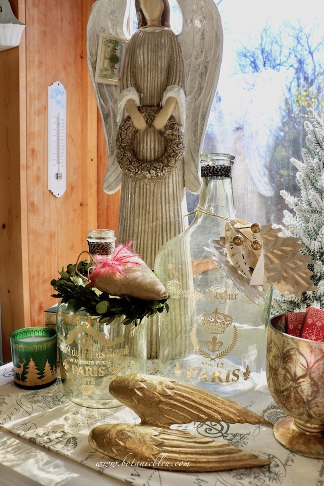 French Country Christmas Event 2019 has reproduction glass bottles with gold colored French script at a fraction of the cost of a real antique from a French flea market