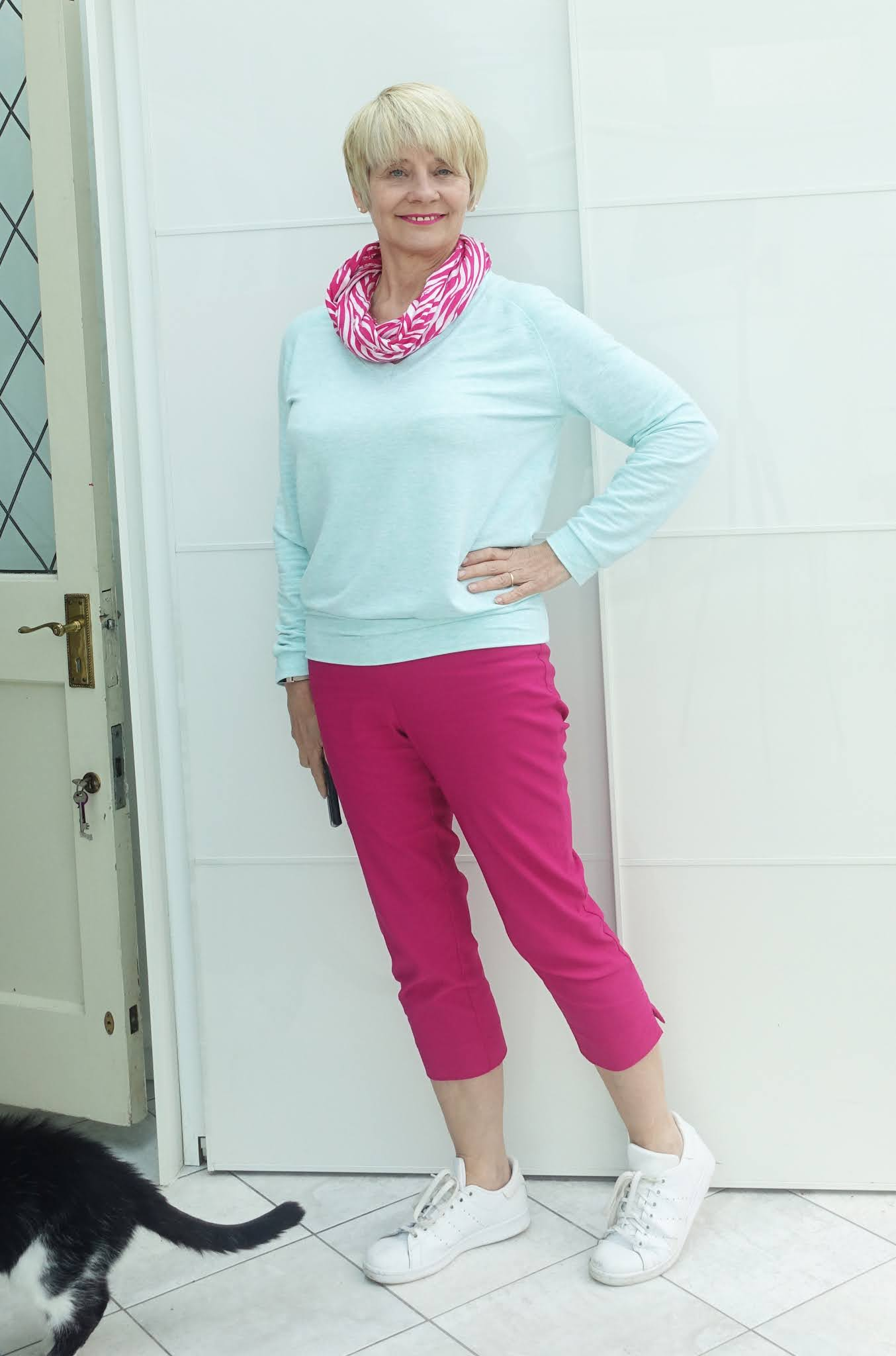 Look smart and crisp in casual wear. Gail Hanlon from Is This Mutton in bright pink cropped trousers from Roman and Mint supersoft sweatshirt from Kettlewell with fuchsia ice scarf