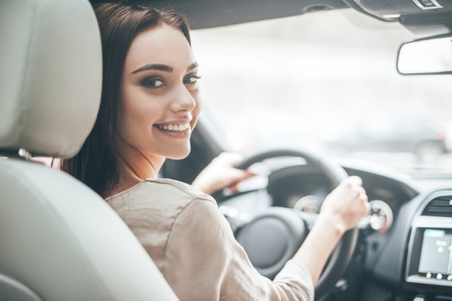 Young Beautiful Girl Smiling Driving A Car